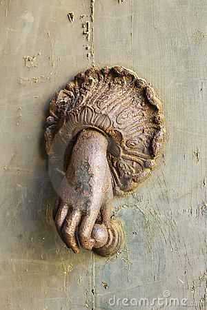Rusted Hand Door Knocker