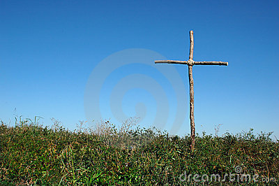 Rustic Cross over blue sky