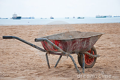 Rustic EarthMover on a Sandy Beach