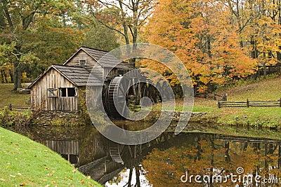 Rustic gristmill in Fall season