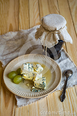 Rustic jam pot,blue mold cheese and grapes