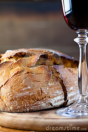 Rustic loaf of bread and red wine
