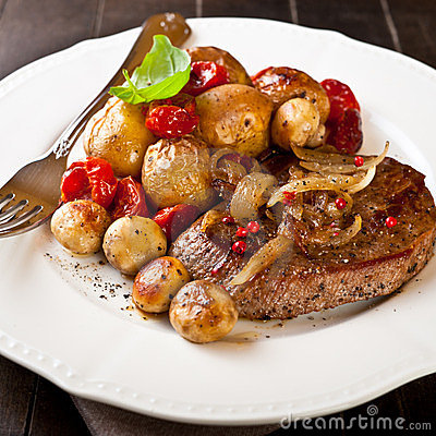 Rustic meat dish with oven baked vegetables