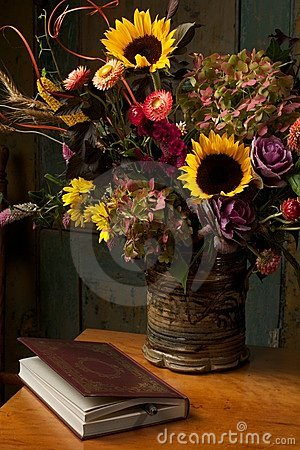 Rustic still life with autumn flowers and book