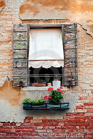 Rustic window with shutters in old venice house