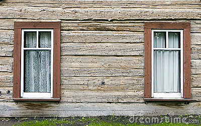 a pair of windows in a frontier style building