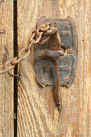 Free Rusty Barn Door Latch And Chain Royalty Free Stock Photography - 6758747