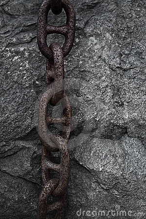 Rusty chain on rock