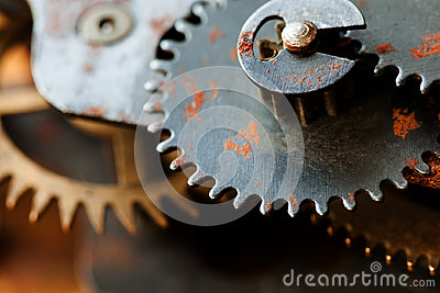 Rusty cogs gear mechanical transmission. industrial machinery vintage design wheels. Shallow depth field, selective Stock Photo