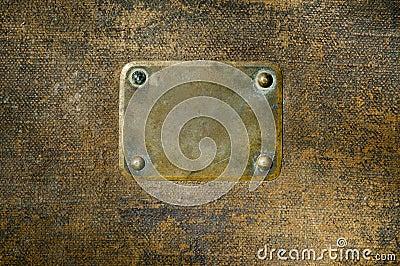Rusty copper name plate.