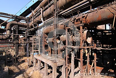 Rusty disused steel plant pipes