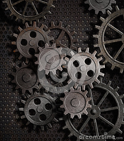 Rusty gears and cogs metal background