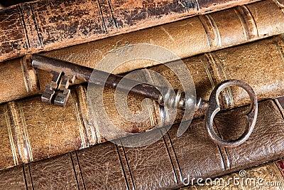 Rusty key on old books