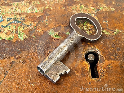 Rusty keyhole with key