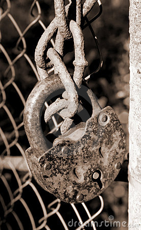 Rusty lock on chains