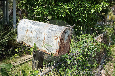 Rusty Mailbox at Abandoned House