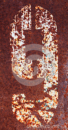 Rusty metal plate with digit nine