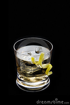 Rusty nail with lemon peel on a black background