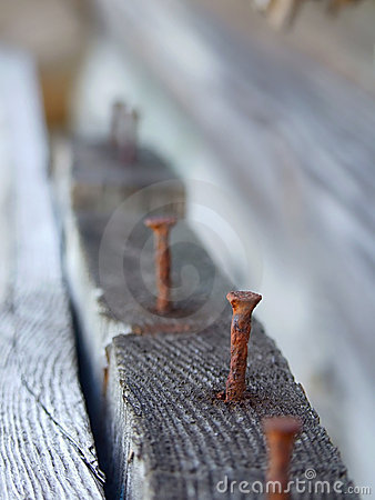 Rusty nail in wood