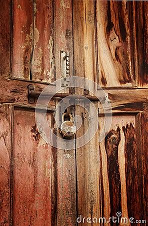 Rusty padlock on door
