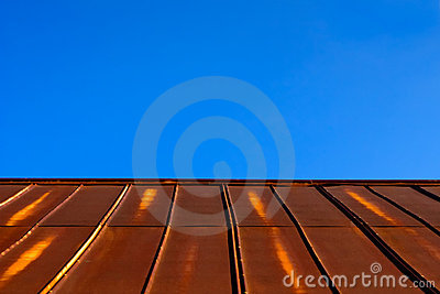 Rusty Tin Metal Roof & Clear Blue Sky
