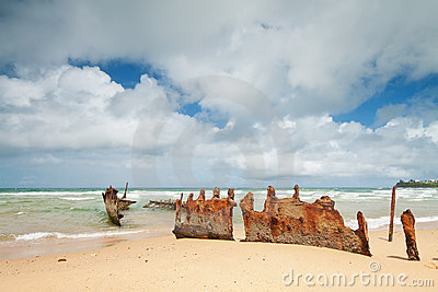 Rusty wreck on australian beach during the day
