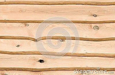 Ruwe houten planken met schors