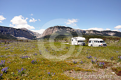 RVs cross arid wilderness