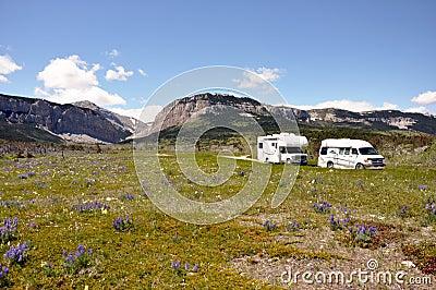 RVs cross arid wilderness