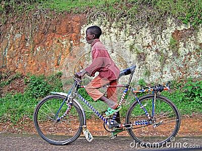 Rwandan Boy on Bycycle Editorial Photography