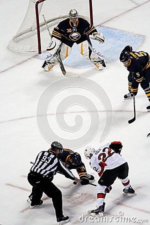 Free Ryan Miller Watches Ice Hockey Faceoff Stock Photo - 13633160