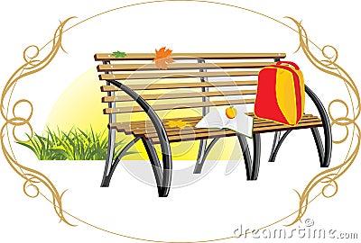 Sac à dos et livre sur le banc en bois