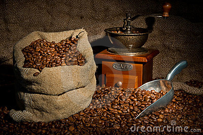 Sack of coffee beans, coffee grinder