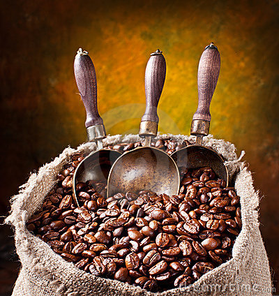 Sack of coffee beans and scoop.