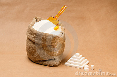 Sack with sugar and plastic scoop