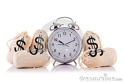 Sacos de dinheiro e de despertador