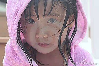 Sad asian girl with hood