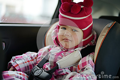 Sad baby in car seat