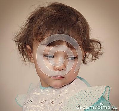 Free Sad Baby Girl Looking Down. Closeup Stock Photos - 35574923