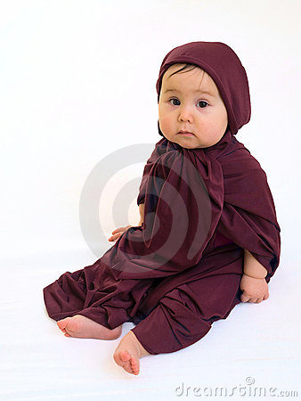 Sad baby girl in muslim dress