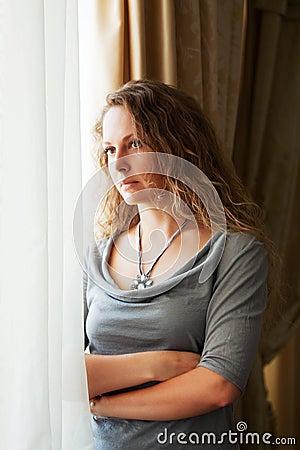 Free Sad Beautiful Fashion Woman Looking Out Window Royalty Free Stock Photography - 17327917