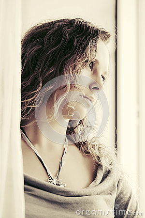 Free Sad Beautiful Woman Looking Out Window Stock Photography - 67649942