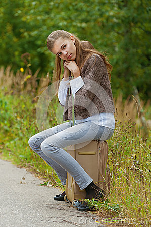 Sad beautiful young woman sitting