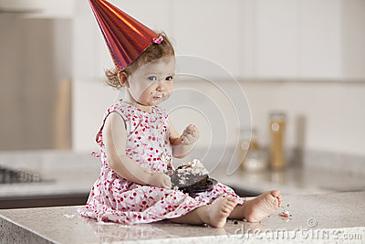 Sad birthday girl eating cake