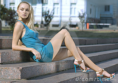 Sad blonde in turquoise dress