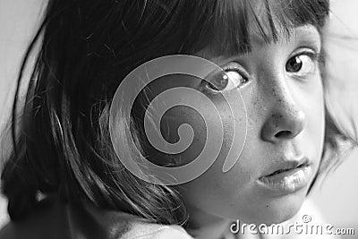 Sad, bored, daydreaming child