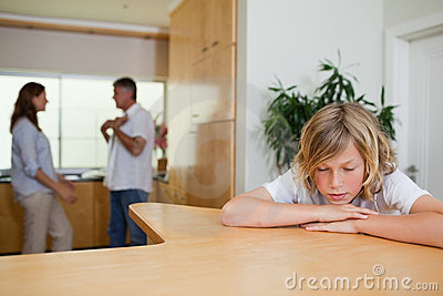 Sad boy has to listen to fighting parents