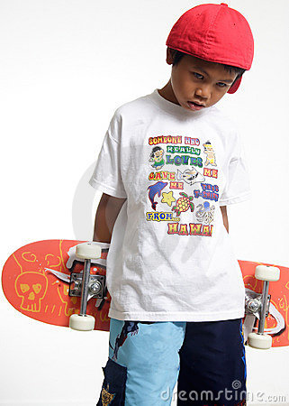 Sad boy holding a skateboard