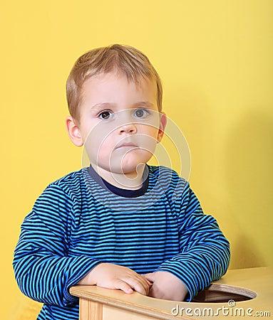 Sad boy in kindergarten