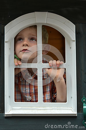 Sad Boy Looking Through The Window Stock Photo Image